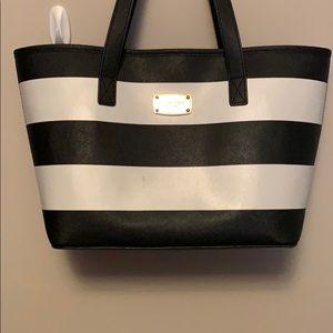 Michael Kors black and white striped handbag.